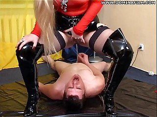 Blonde mistress pissing on guy
