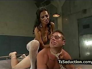 Tranny fucks tied up guy..