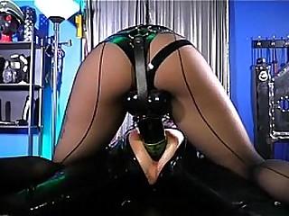 The big dildo for latex slave