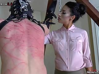 Hooded femdom slave is..